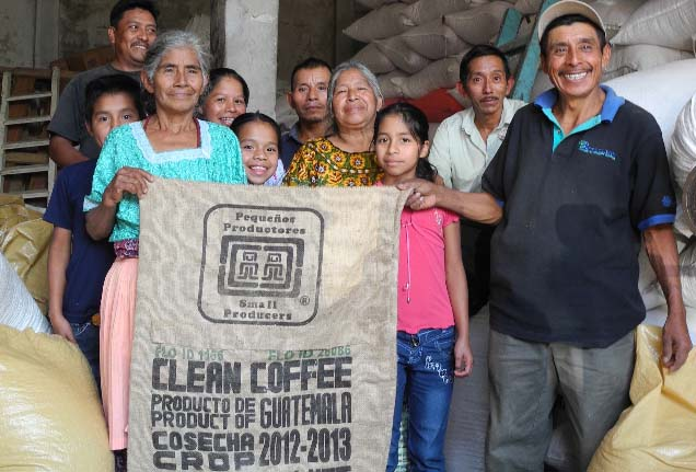 Members of Apecaform proudly display their first export sacks carrying the Small-Producer Symbol SPP